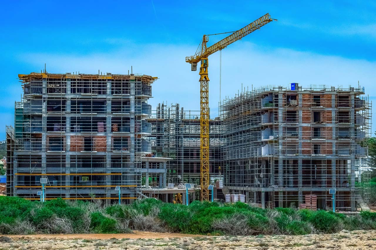 Build or buy an apartment house? Construction Costs, Interest & Financing